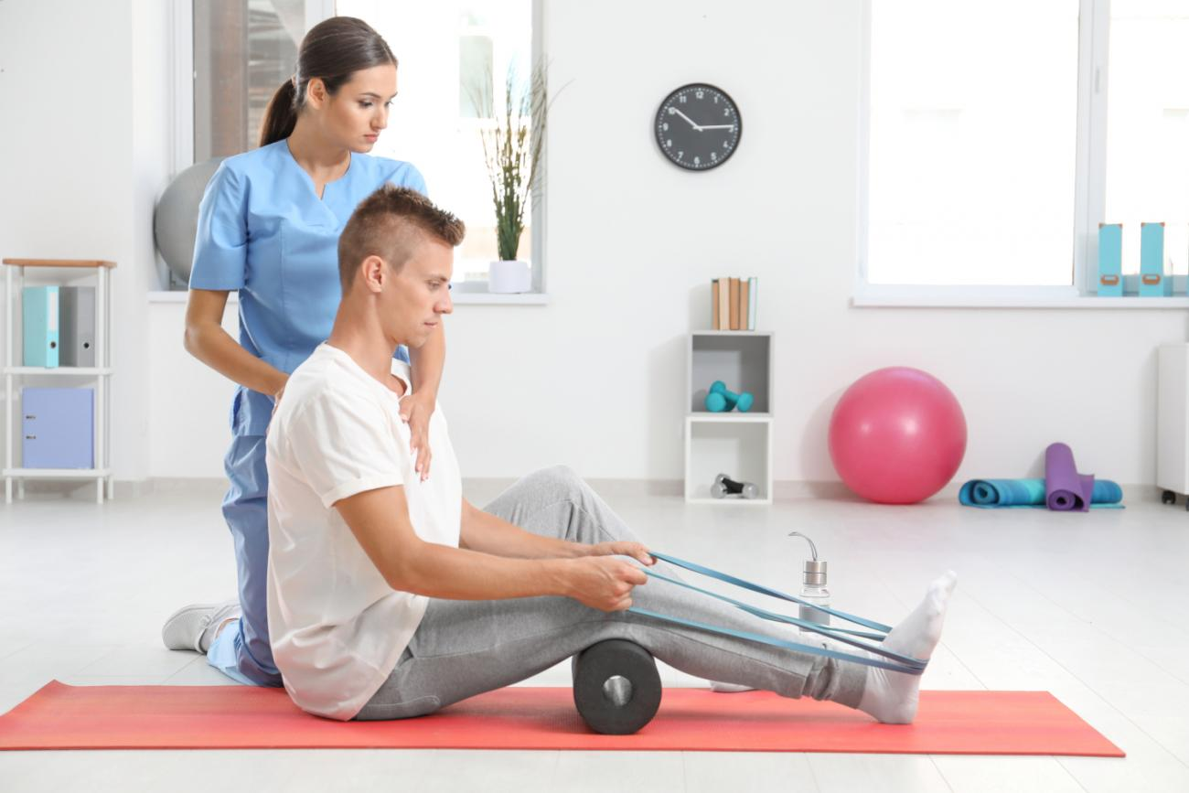 physiotherapist-working-with-young-male-patient